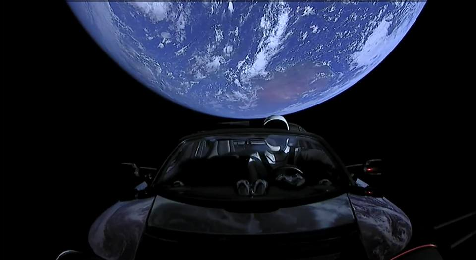 SpaceX Starman earth behind