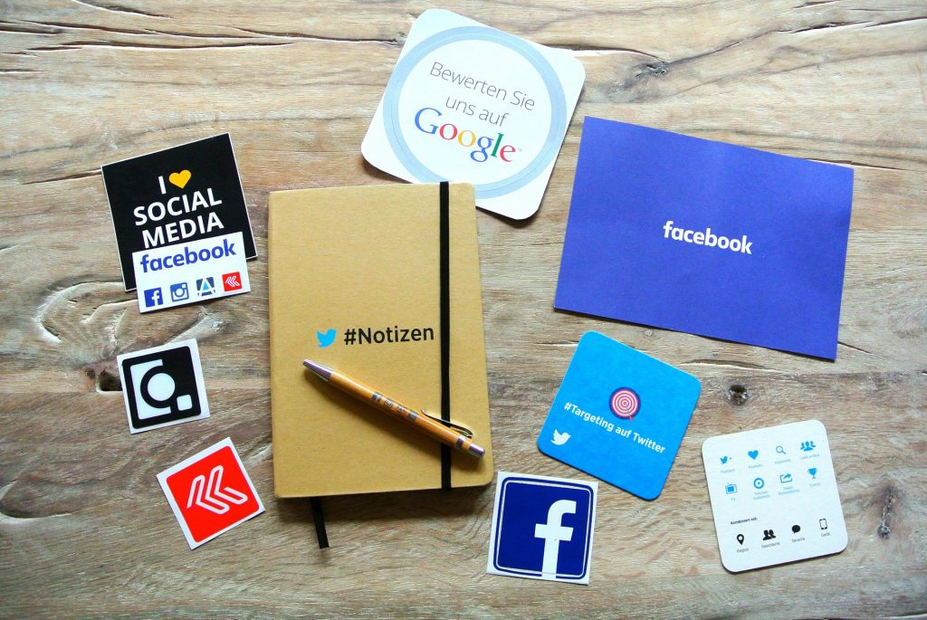 social media icons on paper notes