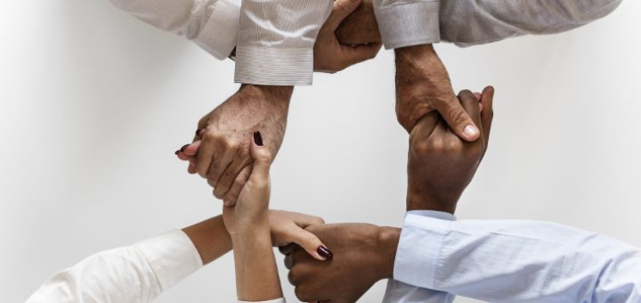 hands hold each other in white shirts