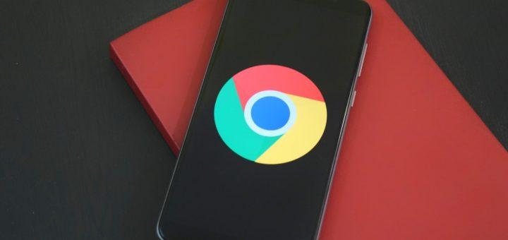 chrome emblem on the dark screen of the phone