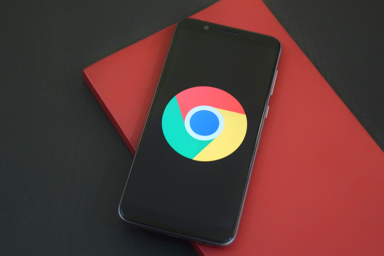 chrome emblem on the dark screen of the phone